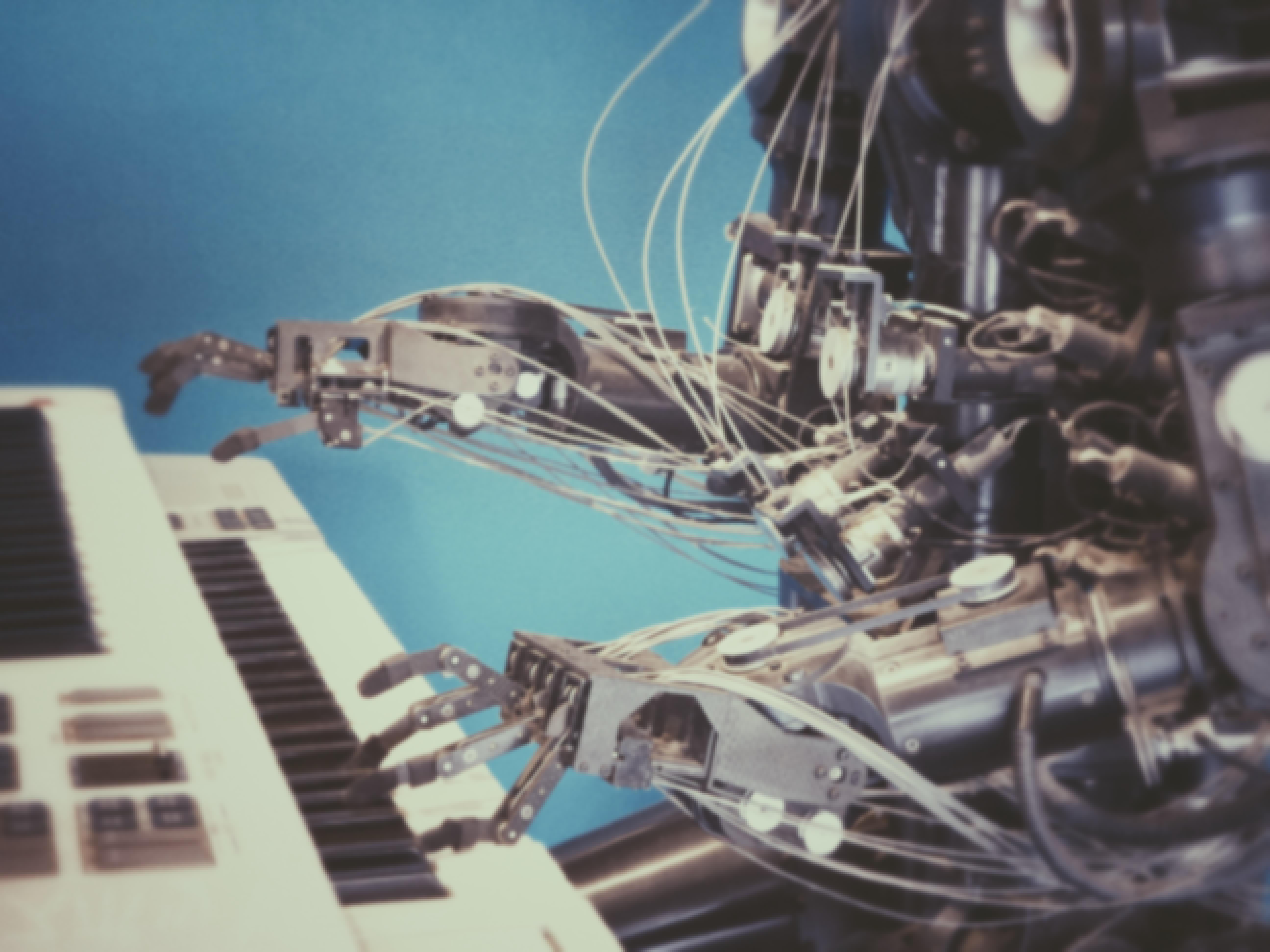 Automated piano play by a robot
