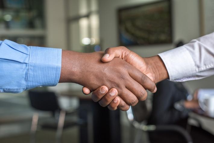 A partnership agreement hand shake